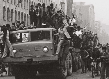 Dozens of demonstrators who have invaded an Iranian army truck, downtown on Wednesday, Jan. 17, 1979 in Tehran proceed in their joyful demonstration on the second day after the Shah's departure.